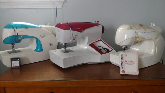 All three sewing machines on one desk